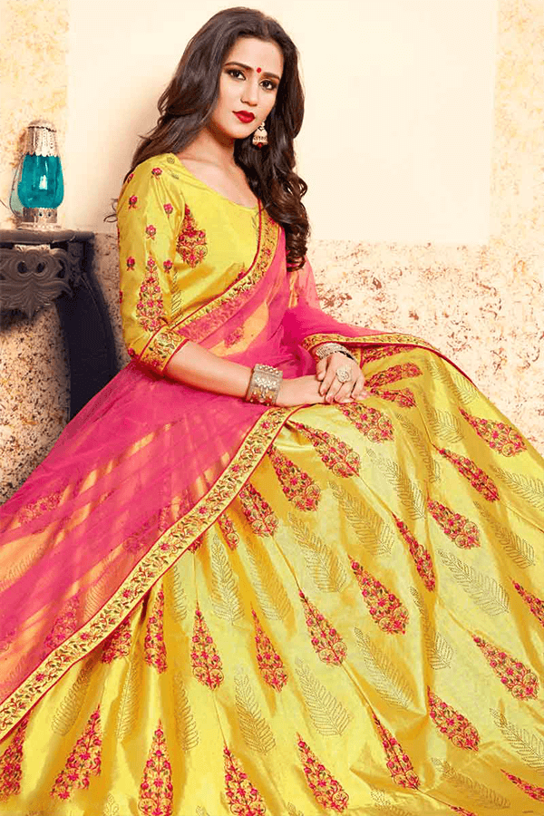 Yellow Color Wedding Lehenga Cholis with Pink Dupatta