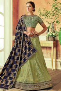 Skip to the end of the images gallery Skip to the beginning of the images gallery Green Color Weaved Silk Bridal Lehenga Choli